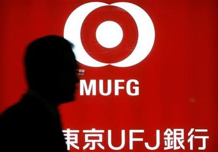 A man walks past a signboard of Mitsubishi UFJ Financial Group (MUFG) at a bank branch in Tokyo November 10, 2008. REUTERS/Stringer