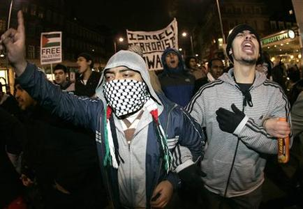 Pro-Palestinian demonstrators protest in response to the air strikes on Gaza near the Israeli Embassy in London December 29, 2008. REUTERS/Luke MacGregor