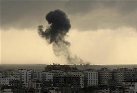 Smoke rises after an Israel air strike in Gaza December 31, 2008. REUTERS/Suhaib Salem