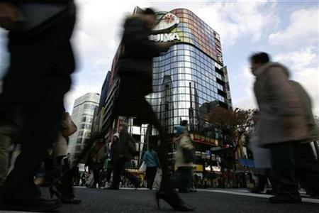 Pedestrians walk in Ginza in Tokyo in this December 1, 2008 file photo. Thousands of shoppers queued for hours in front of department stores across Japan on Friday to buy limited-edition, traditional New Year's ''goodie'' bags in what has become one of the biggest events of the holiday season. REUTERS/Yuriko Nakao