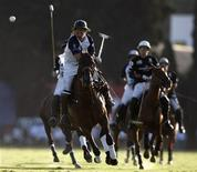 <p>Argentine polo player Luca Monteverde of La Dolfina hits the ball during the Argentina Open final match against Ellerstina in Buenos Aires, December 13, 2008. Argentina is the world's undisputed polo mecca, home to the game's best players and horses. Now the country is transforming that status into a full-blown business. REUTERS/Enrique Marcarian</p>