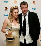 <p>L'attrice Patrizia Arquette con il marito Thomas Jane, del 18 settembre 2005. REUTERS/Kimberly White/Files</p>