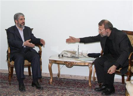 Iranian Parliament Speaker Ali Larijani leans forward to shake hands with Hamas leader Khaled Meshaal (L) before a meeting at the Iranian embassy in Damascus January 7, 2009. REUTERS/Khaled al-Hariri