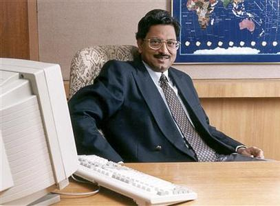 Satyam Computer Services chairman Ramalinga Raju poses in his office in Hyderabad in this undated handout. REUTERS/Handout