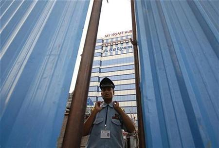 A security guard is seen adjusting his collar near a construction site inside the premises of Satyam Computer Service in the southern Indian city of Hyderabad January 9, 2009. REUTERS/Krishnendu Halder