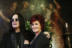 <p>Ozzy and Sharon Osbourne pose in front of some of their belongings to be auctioned in Beverly Hills, California in this November 26, 2007 file photo. REUTERS/Mario Anzuoni</p>