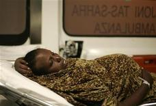 <p>A pregnant Somali would-be immigrant lies in an ambulance after arriving at the Armed Forces of Malta Maritime Squadron base in Valletta's Marsamxett Harbour, August 11, 2008. REUTERS/Darrin Zammit Lupi</p>
