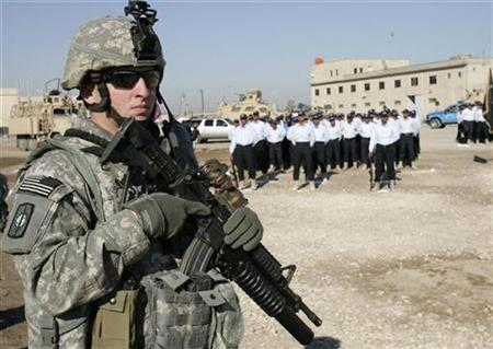 A U.S. soldier stands guard during a police graduation ceremony at Al-Furat Iraqi Police Training Center in Baghdad, January 14, 2009. REUTERS/ Saad Shalash