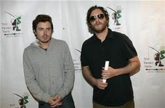 "<p>Actors Casey Affleck (L) and Joaquin Phoenix pose for photographers as they arrive for a staged reading of ""The World of Nick Adams,"" at Davies Symphony Hall in San Francisco, California October 27, 2008 REUTERS/Robert Galbraith</p>"