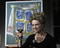 <p>Natalya Kurnikova, proprietaria della galleria d'arte di Mosca che ha acquistato il dipinto di Vladimir Putin. REUTERS/Alexander Demianchuk</p>