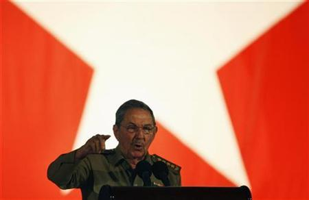 Cuba's President Raul Castro gestures while addressing the audience during the 50th anniversary of the Cuban revolution in Santiago de Cuba January 1, 2009. REUTERS/Claudia Daut