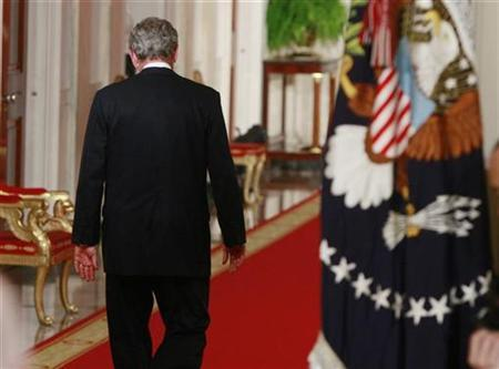 President Bush walks away after saying goodbye to staff and friends after his primetime address from the White House, January 15, 2009. REUTERS/Jason Reed