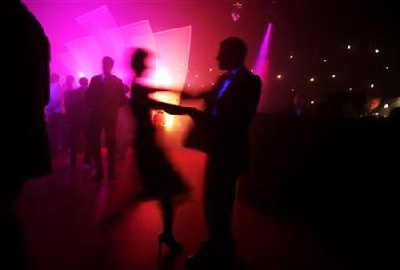 Revellers dance at an office Christmas party in London December 13, 2007. REUTERS/Finbarr O'Reilly