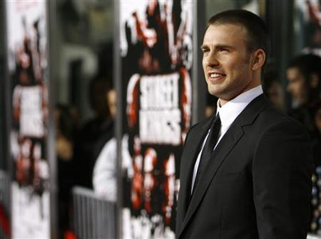 Chris Evans poses at the Grauman's Chinese Theatre in Hollywood, California April 3, 2008. REUTERS/Mario Anzuoni