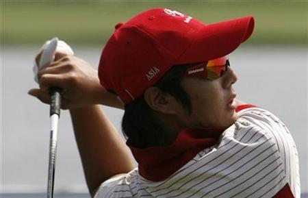 Asia's Ryo Ishikawa of Japan tees off on the third hole during the second day of foursomes matches against Europe at the Royal Trophy golf tournament in Chonburi province, near Bangkok, January 10, 2009. REUTERS/Sukree Sukplang