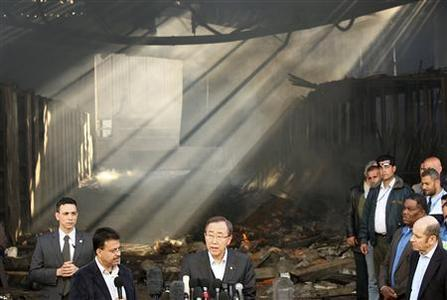 U.N. Secretary-General Ban Ki-moon speaks to journalists in Gaza City in front of the United Nations compound that was struck by Israeli fire during Israel's offensive, January 20, 2009. REUTERS/Suhaib Salem