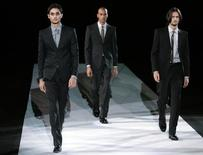 <p>Models display creations as part of the Giorgio Armani Fall/Winter 2009/10 men's collections during Milan Fashion Week January 20, 2009. REUTERS/Alessandro Garofalo</p>