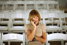 <p>Vogue Editor-in-Chief Anna Wintour speaks on a cell phone during New York Fashion Week, September 7, 2007. REUTERS/Eric Thayer</p>