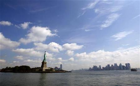 The Statue of Liberty and the New York City Skyline are seen in this photograph taken from a tour boat in New York Harbor, June 30, 2008. REUTERS/Mike Segar