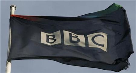A tattered flag flies in a strong breeze above the BBC headquarters November 21, 2008. REUTERS/Andrew Winning.