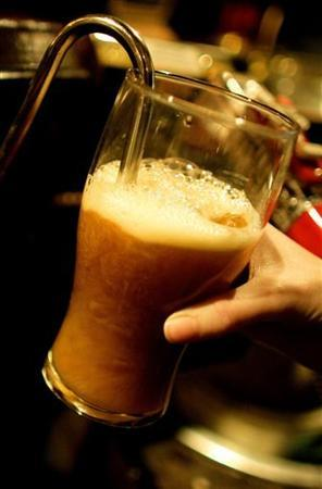A pint is pulled at a pub in central London, November 23, 2005. REUTERS/Dylan Martinez