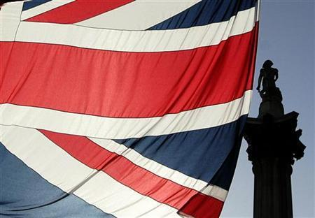 Nelson's Column is seen behind a Union flag in Trafalgar Square in London February 19, 2005. REUTERS/Russell Boyce