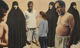 <p>A staff member views an untitled painting by Ahmad Morshedloo at The Saatchi Gallery in west London January 28, 2009. The painting forms part of a forthcoming exhibition entitled New Art From The Middle East. REUTERS/Toby Melville</p>