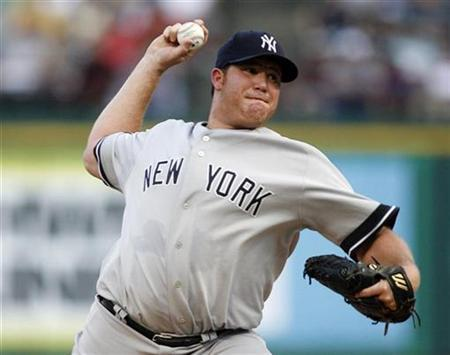 New York Yankees starting pitcher Sidney Ponson pitches in the first inning of their American League baseball game against the Texas Rangers in Arlington, Texas August 6, 2008. REUTERS/Mike Stone