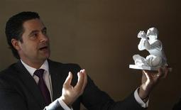 <p>Christian Kurtzke, Chief Executive Officer of Meissen, Europe's oldest porcelain manufacturer, holds a figurine during an interview with Reuters in his office at the Meissen factory in Meissen January 22, 2009. After 300 years crafting baroque porcelain for French kings and Russian tsars, Germany's Meissen has launched an in-house revolution to weather the economic downturn. REUTERS/Tobias Schwarz</p>