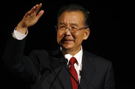 China's Premier Wen Jiabao addresses a dinner held by the China Britain Business Council at the Natural History Museum in London February 1, 2009. Wen said on Sunday that developing nations should have more say in international financial institutions as countries seek to reshape the economic order after the credit crisis. REUTERS/Andrew Winning