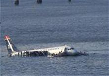 <p>Passengers stand on the wings of a U.S. Airways plane as a ferry pulls up to it after it landed in the Hudson River in New York, in this file photo from January 15, 2009. REUTERS/Brendan McDermid</p>