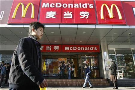 A man walks past a McDonald's outlet in Beijing in this April 2, 2007 file photo. REUTERS/Claro Cortes IV/Files
