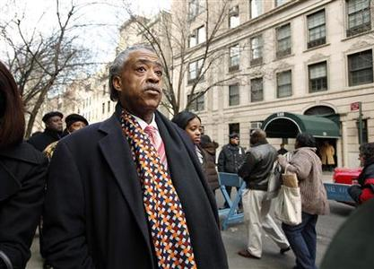 Reverend Al Sharpton participates in a protest outside the home of Bernard Madoff in New York February 7, 2009. Madoff, who was arrested by U.S. authorities in December, is accused of running a long-standing Ponzi scheme, illegally taking money from new investors to pay existing investors. Madoff has estimated losses of $50 billion from the alleged scheme, U.S. authorities say. REUTERS/Chip East