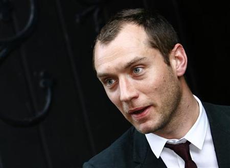 Actor Jude Law leaves St Thomas Church after the thanksgiving service for the life of film director Anthony Minghella in Newport on the Isle of Wight in this file photo from April 26, 2008. REUTERS/Luke MacGregor
