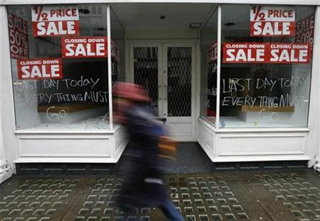 A pedestrian passes a closed shop on Bond Street, in London February 9, 2009. REUTERS/Andrew Winning