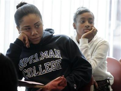 Freshman students Laurah Pollonais and Dalicia Barker listen during a class at Spelman College in Atlanta, Georgia in this picture taken February 12, 2009. REUTERS/Tami Chappell