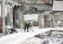<p>Les autorités chinoises ont déclenché artificiellement les premières chutes de neige de l'hiver sur Pékin, dans l'espoir de mettre un terme à la sécheresse persistante qui affecte la capitale chinoise. /Photo prise le 17 février 2009/REUTERS/Christina Hu</p>
