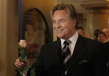"<p>U.S. actor Don Johnson arrives with a rose for a musical premiere of ""Miami Nights"" in Munich November 7, 2007. REUTERS/Michaela Rehle</p>"