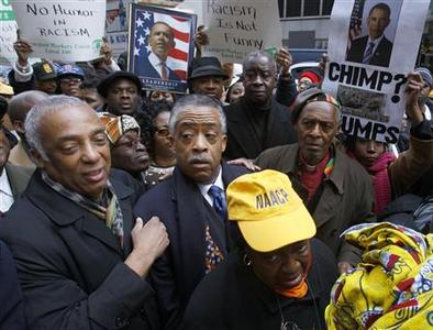 Rev. Al Sharpton (C) marches with protesters outside the News Corp. headquarters in New York February 19, 2009. REUTERS/Brendan McDermid