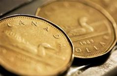 <p>Canadian one dollar coins, also known as loonies, are displayed in Montreal, September 19, 2007. The Canadian dollar eased slightly against the U.S. dollar on Wednesday after breaching 99 U.S. cents overnight, as the hard-hit greenback recovered from Tuesday's U.S. interest rate cut and both Canadian and U.S. inflation reports came in below expectations. REUTERS/Christinne Muschi</p>