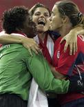 <p>U.S. women's soccer players Briana Scurry (L), Mia Hamm (C) and Brandi Chastain celebrate after beating Brazil in the gold medal match at the Athens 2004 Olympic Games in this August 26, 2004 file photo. REUTERS/Jeff J Mitchell/Files</p>