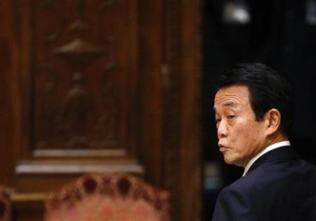 Japan's Prime Minister Taro Aso leaves the Lower House Budget Committee at the parliament in Tokyo February 17, 2009. REUTERS/Toru Hanai