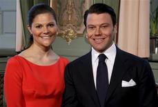 <p>Undated picture shows Sweden's Crown Princess Victoria and Daniel Westling as they pose in the Royal Palace in Stockholm. The court announced the engagement of Crown Princess Victoria to Daniel Westling after informing government ministers on February 24, 2009 at Stockholm's Royal Palace. The wedding will take place in the early summer of 2010, the royal court said. REUTERS/SCANPIX/Swedish Royal Court Handout</p>