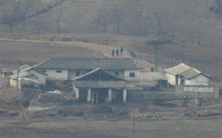 A village in the North Korean county of Kaepoong is seen in this picture taken from a South Korean observation post in Paju, about 45 km (28 miles) north of Seoul, February 25, 2009. North Korean leader Kim Jong-il has been touring the province where the country has been preparing for a rocket launch, the North's media said on Wednesday, in what a South Korean daily said could be a precursor of a launch. REUTERS/Lee Jae-Won