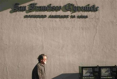 A man walks past the ''San Francisco Chronicle'' building in San Francisco, California February 24, 2009. REUTERS/Robert Galbraith