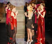 <p>Italian actress and designer Valeria Marini (C) acknowledges the applause at the end of the presentation of her Seduzioni Diamonds Valeria Marini Fall/Winter 2009/10 women's collection during Milan Fashion Week February 25, 2009. REUTERS/Stefano Rellandini</p>