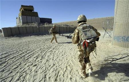 British soldiers return to their base after a patrol in Central Helmand province November 16, 2007. REUTERS/Steve Lewis