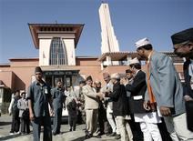 <p>Prime Minister Pushpa Kamal Dahal (light suit) is greeted by the officials as he arrives at Narayanhiti Palace Museum to inaugurate in Kathmandu February 26, 2009. REUTERS/Shruti Shrestha</p>