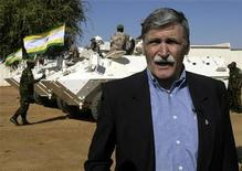 <p>Former UN commander during the Rwanda genocide, Canadian General Romeo Dallaire, looks on as Africa Union armoured vehicles deploy in Sudan's Darfur region town of el-Fasher, November 18, 2005. REUTERS/Mohamed Nureldin</p>