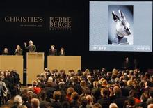 <p>Christie's auctions a bronze rabbit head made for the Zodiac fountain of the Emperor Qianlong's Summer Palace in China from the private art collection of late French fashion designer Yves Saint Laurent at the Grand Palais Museum in Paris February 25, 2009. REUTERS/Regis Duvignau</p>